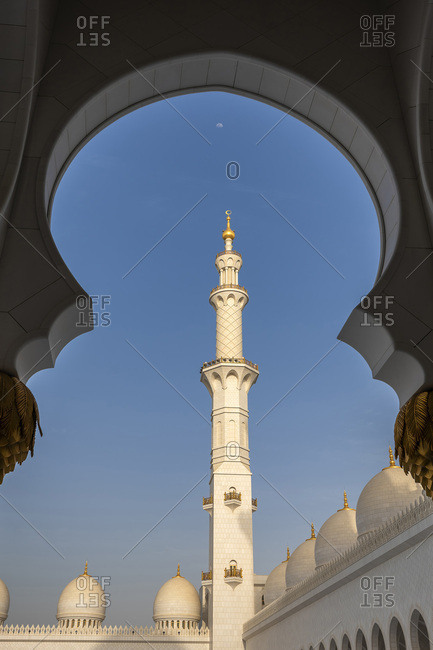 Minaret aligned with moon, framed in archway, Sheikh Zayed Mosque