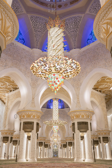 Sheikh Zayed Grand Mosque, Abu Dhabi, United Arab Emirates - March 16, 2019: Illuminated interior with crystal chandeliers in Sheikh Zayed Mosque