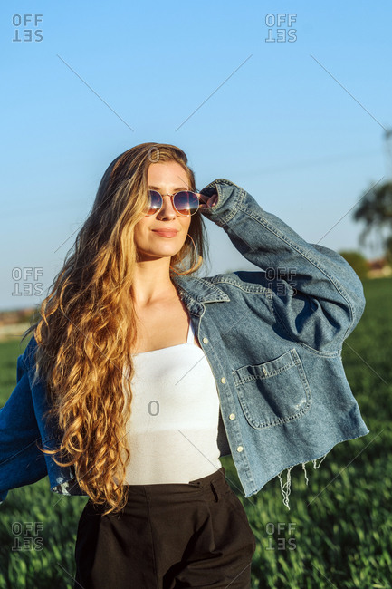 Beautiful Young Woman On A Field At Sunset