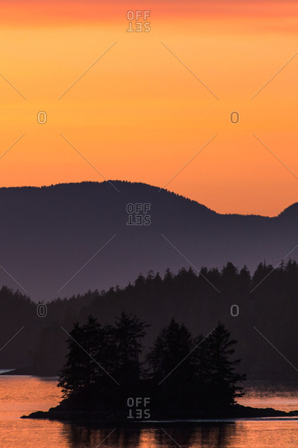 Beautiful orange sunset over lake and forest