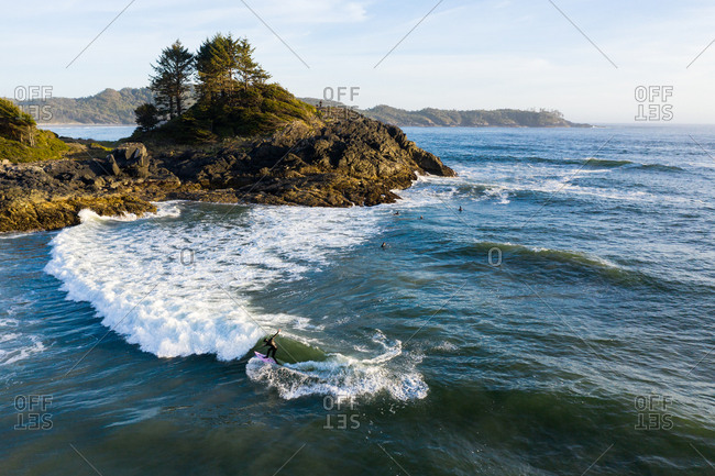 Surfers on surfboards in the ocean waves