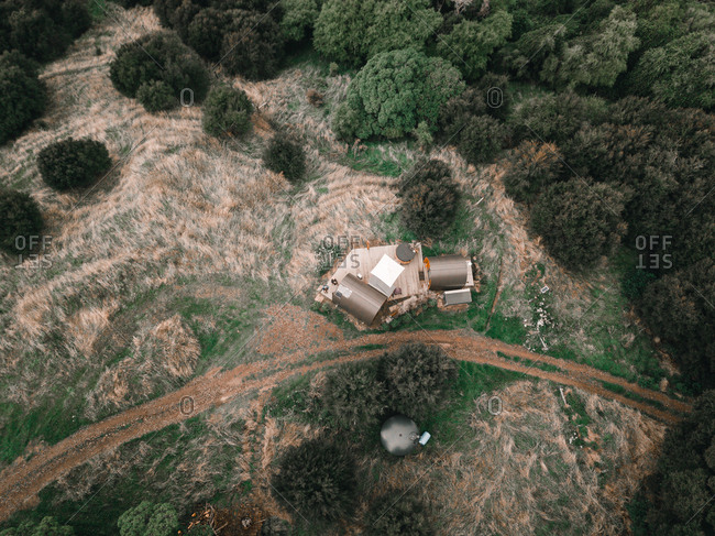 Aerial view of camping in bushes with small houses and rest area in Te Wepu Intrepid Pods New Zealand