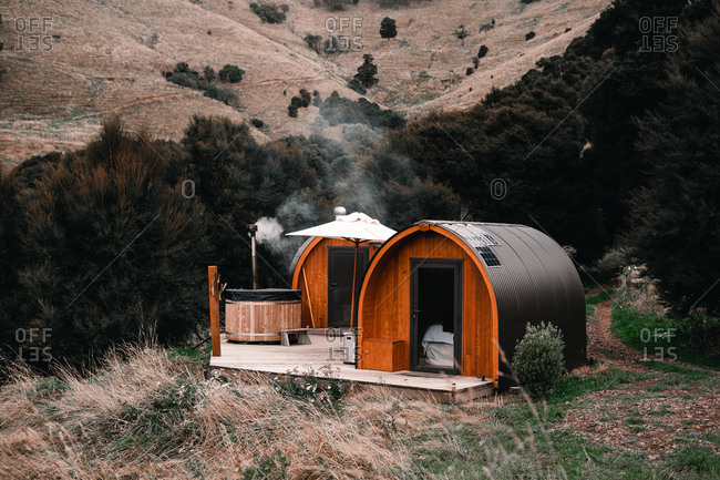Cozy cabins and wooden outdoors hot tubs in Te Wepu Intrepid Pods New Zealand