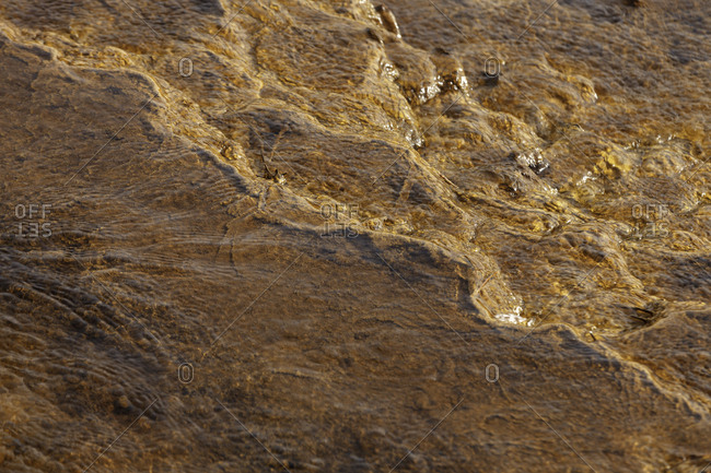From above beautiful orange streams and transitions on rock in Mines of Riotinto Huelva