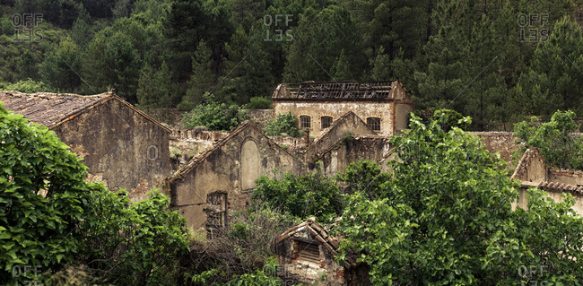 Abandoned buildings among vegetation in Riotinto Huelva Spain