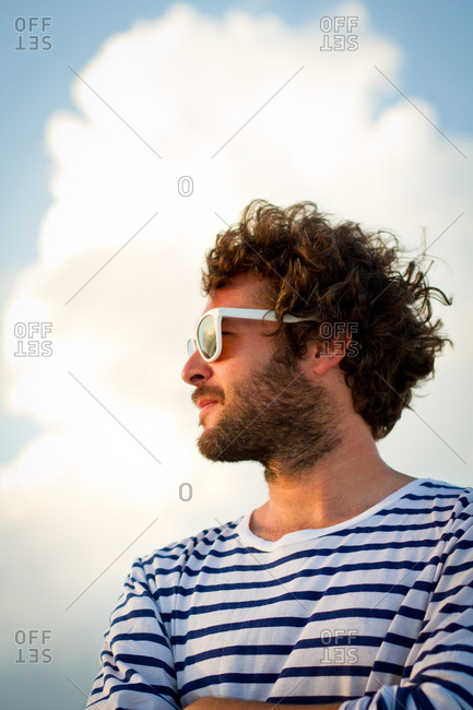 Man looking away in turquoise sea