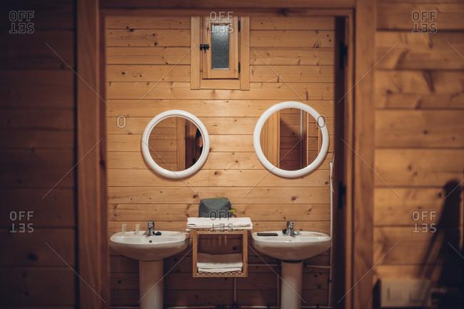 Bathroom in wooden house with opened door