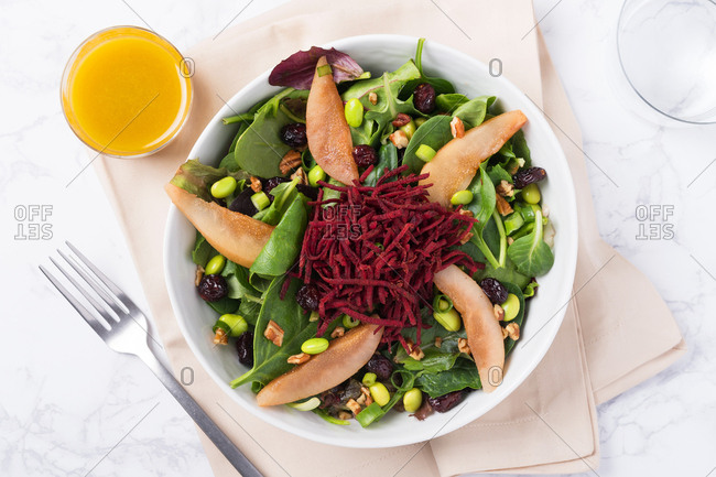 Poached pear and beet salad