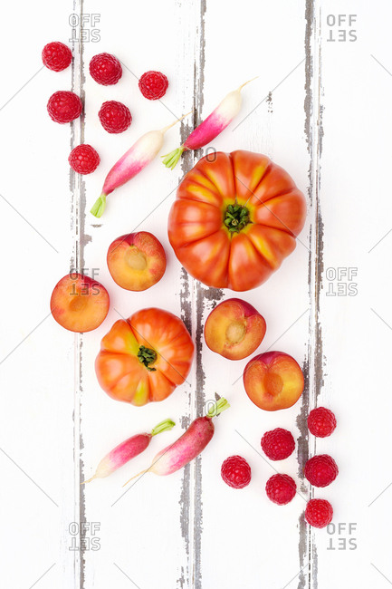 Red produce on wooden table