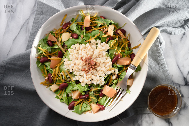 Overhead view of  roast pear and grain salad bowl