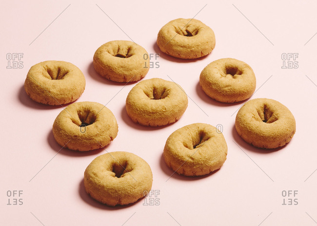 Plain donuts on a light pink background