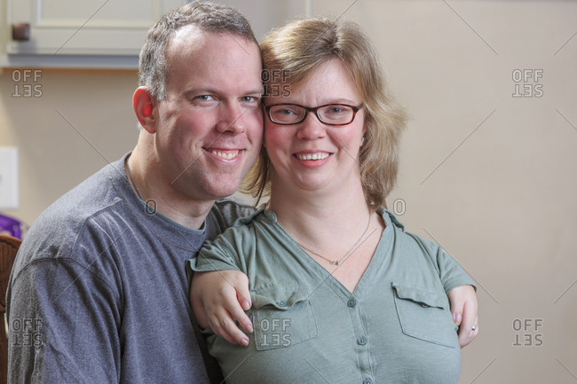 Portrait of a woman with TAR Syndrome and her husband.