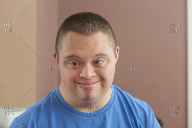 Portrait of a Teen boy with Down Syndrome .