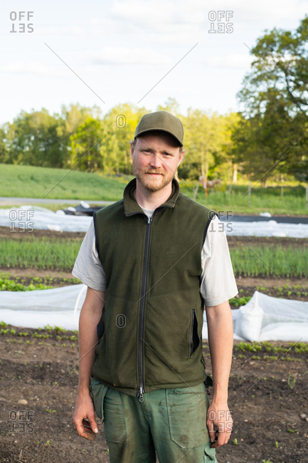 Portrait of a farmer standing in a garden