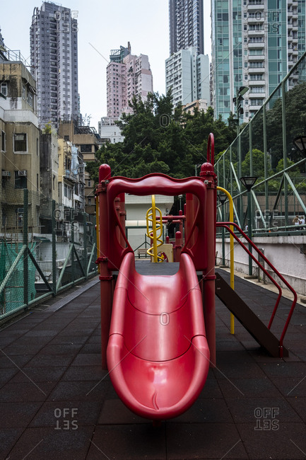 Hong Kong, China - September 7, 2018: Red slide on a playground in Hong Kong