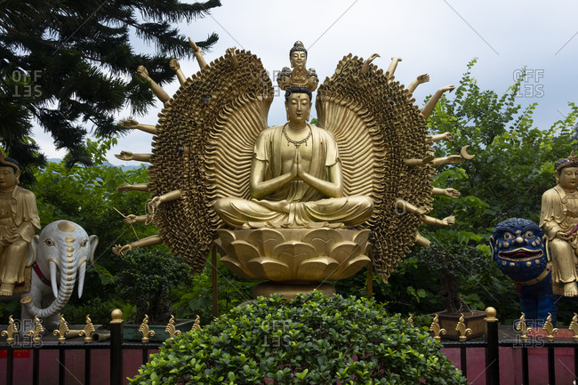Hong Kong, China - September 8, 2018: Buddha sculpture at Ten Thousand Buddhas Monastery