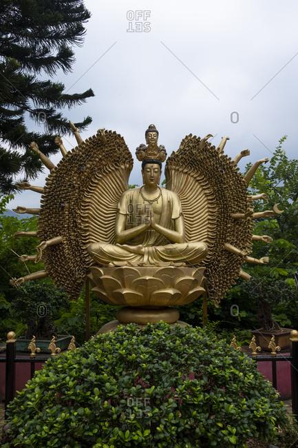 Hong Kong, China - September 8, 2018: Golden Buddha statue at Ten Thousand Buddhas Monastery