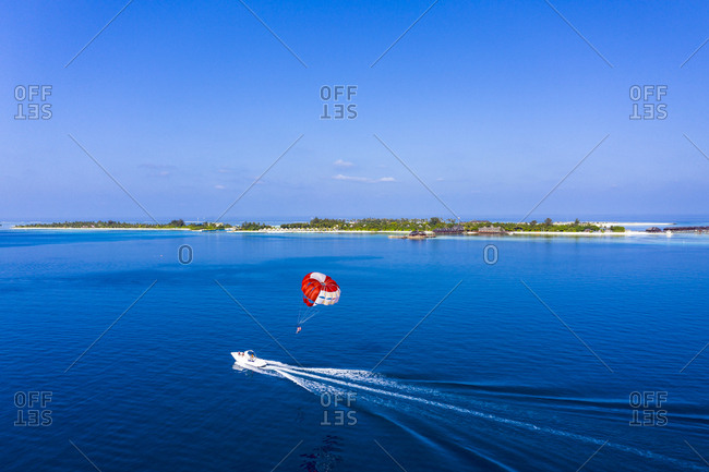 April 1, 2019: Maldives- South Male Atoll- aerial view of paraglider on the sea at an atoll