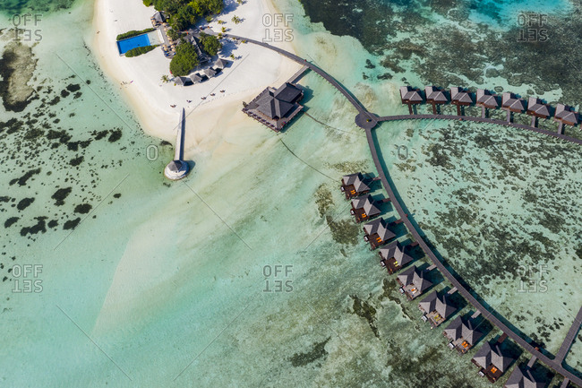 Maldives- South Male Atoll- aerial view of resort with bungalows on island Olhuveli
