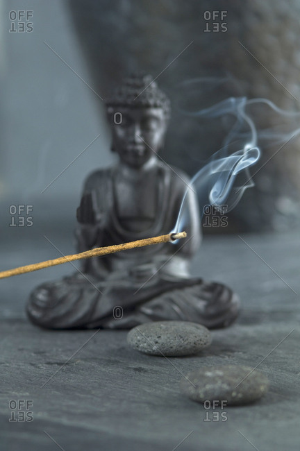 Joss stick and Buddha figurine
