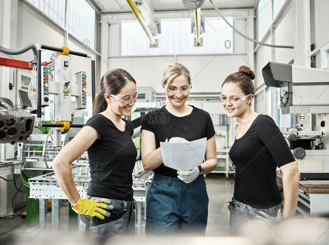 Three women at work during conversation