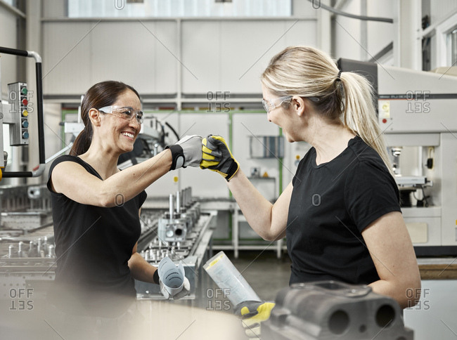 Two woman at work- fist bump