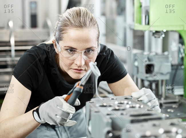 Young woman working with a pliers