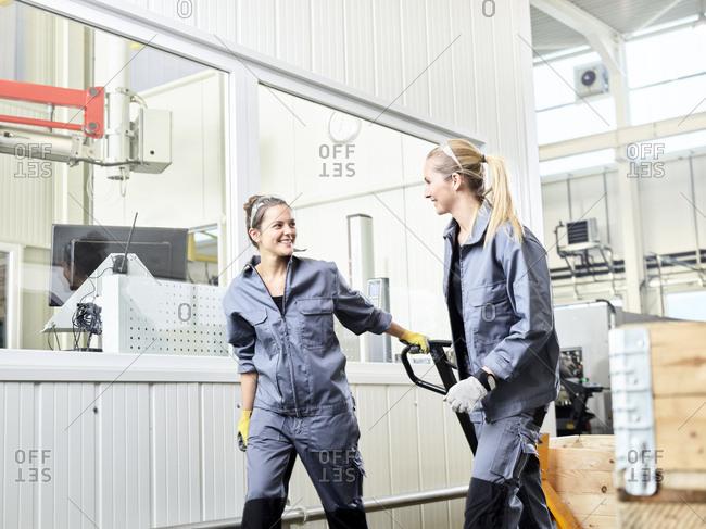 Industry- women using pallet jack