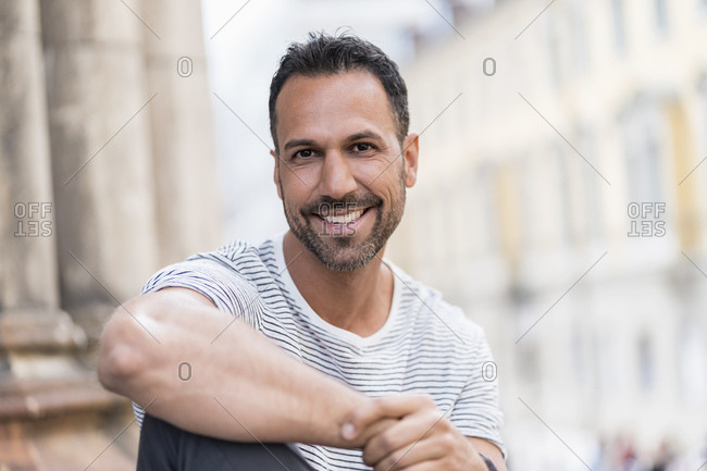Portrait of smiling relaxed man in the city