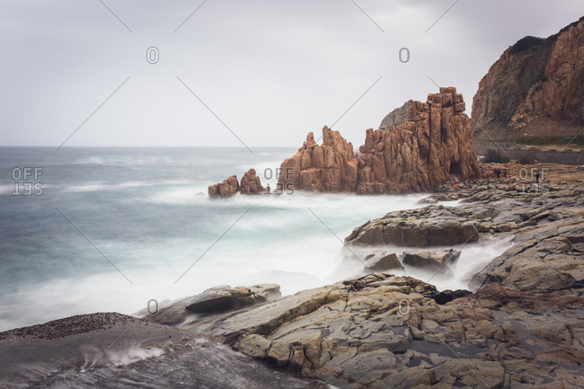 Italy- Sardinia- Tortoli- Arbatax- rocks in the surf