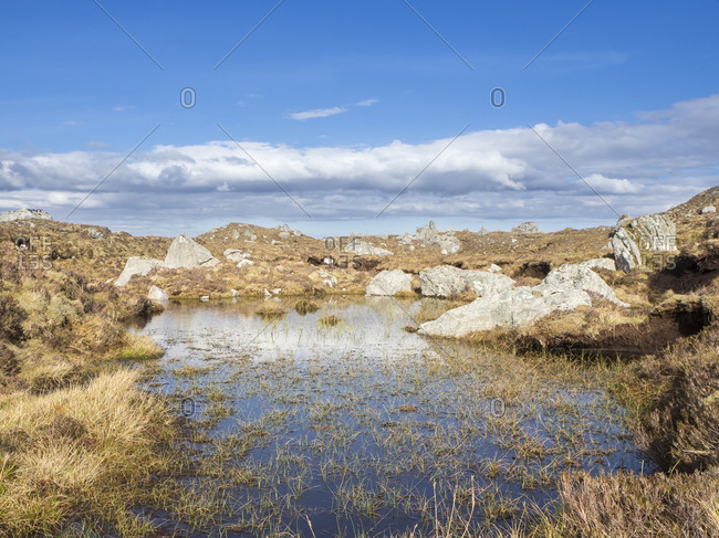 Great Britain- Scotland- Northwest Highlands- pond and boulders