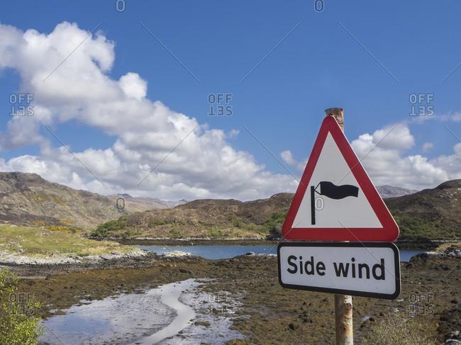 Great Britain- Scotland- Northwest Highlands- near Kylesku- landscape with sign warning of side wind