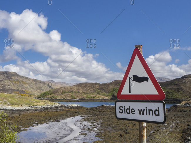 Great Britain- Scotland- Northwest Highlands- near Kylesku- landscape with sign warning of side wind