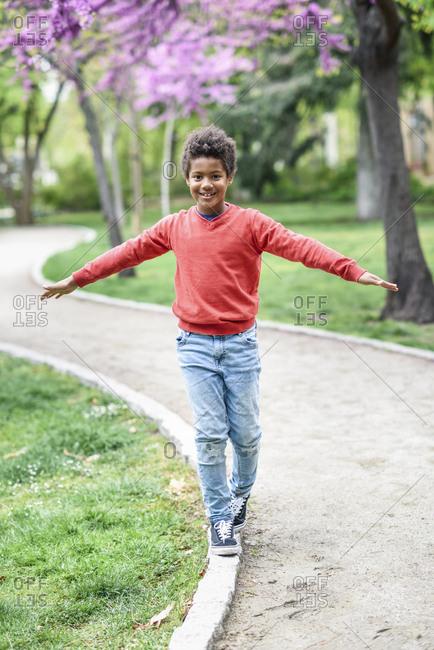 Happy boy balancing in a park