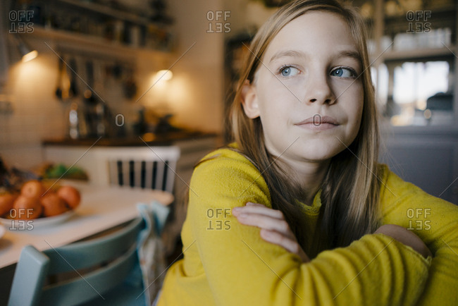 Portrait of pensive girl at home