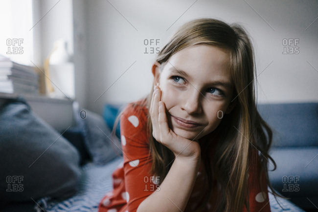 Girl at home resting her head in hand