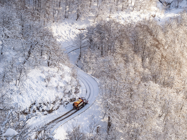 Spain- Asturia- Picos de Europa- Mirador De Piedrashistas- snow plow truck clearing road in winter