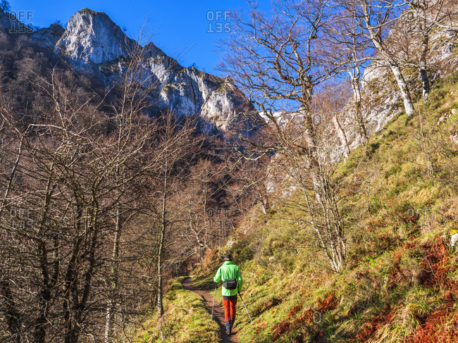 Spain- Asturia- Cantabrian Mountains- senior man on a hiking trip