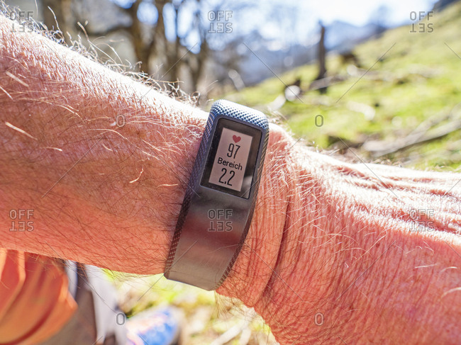 Smartwatch with data on wrist of a hiker