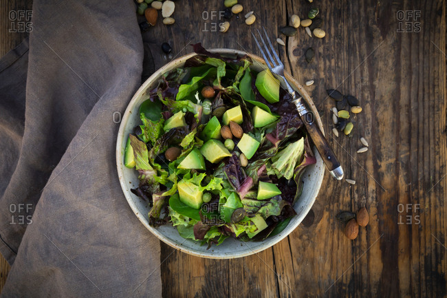 Various leaf salad with avocado- roasted seeds- almonds and soy beans