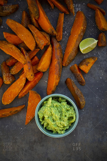 Sweet potato wedges with avocado dip and fleur de sel