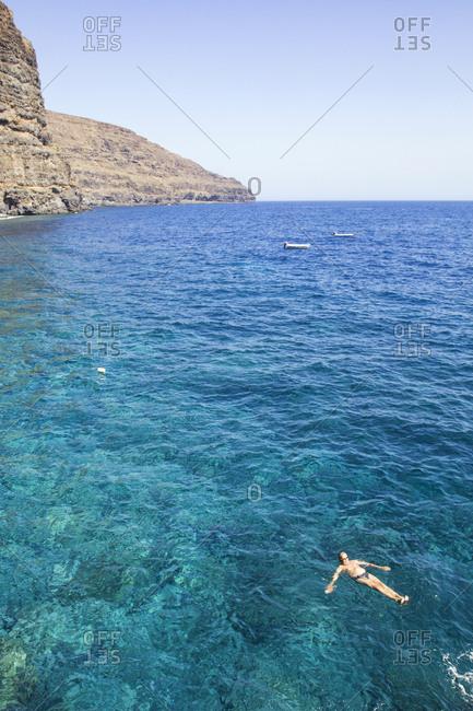 Spain- Canary Islands- La Gomera- La Rajita- senior man swimming in the Atlantic