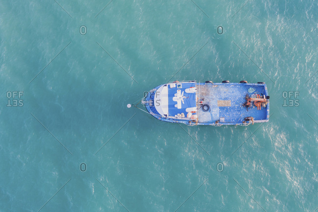Portugal- Algarve- Sagres- aerial view of fishing boat on the sea