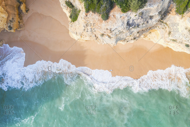 Portugal- Algarve- Lagoa- Praia da Corredoura-  aerial view of beach- rocky coastline and sea