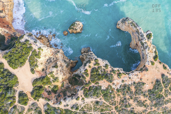 Portugal- Algarve- Lagoa- Praia da Marinha- aerial view of rocky coastline and sea