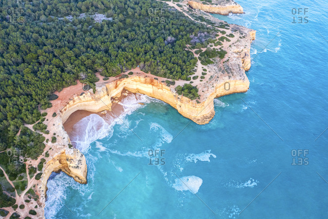 Portugal- Algarve- Lagoa- Praia da Corredoura- aerial view of forest- rocky coastline and sea