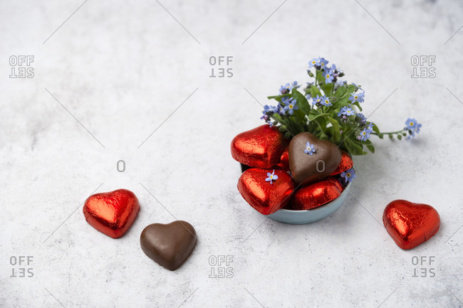Chocolate hearts and Forget-me-not on marble