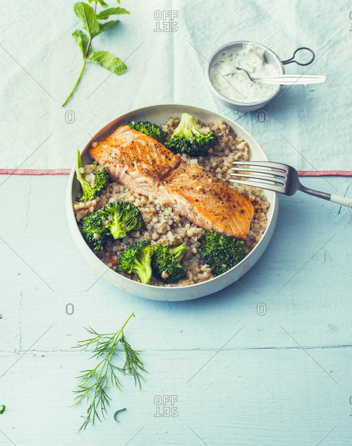 Fried salmon with buckwheat pilaf and broccoli in a bowl