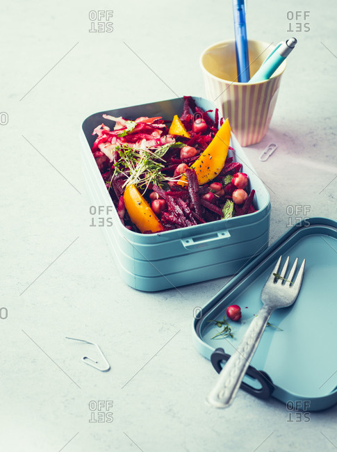 Beetroot salad with chickpeas and mango fruit in a lunch box