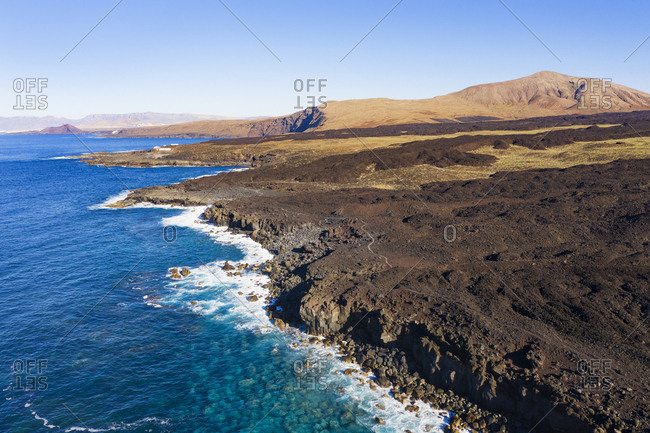 Spain- Canary Islands- Lanzarote- Tinajo- Los Volcanos nature park- aerial view over rocky coast